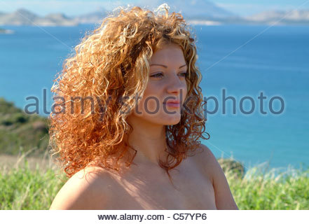 Young woman on holiday in Greece with Greek Islands and Aegean Sea - Stock Image