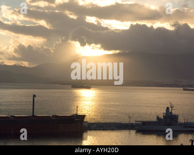 Dusk over the Bay of Gibraltar, Europe, with ships and tankers - Stock Image
