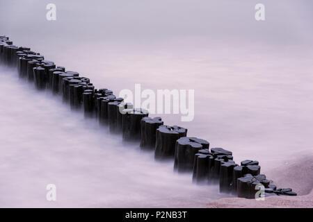 Wave Breaker, Sunset, Beach, Long Exposure, Baltic Sea, Darss, Zingst, Germany - Stock Image