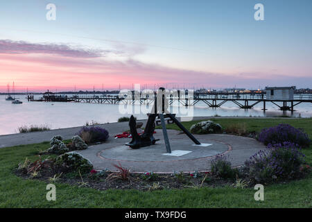 The anchor war memorial at the Hardway slipway in Gosport, Hampshire at sunrise - Stock Image