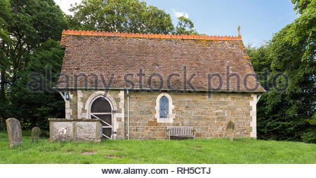 St Olave's Church in the parish of Ruckland, Lincolnshire Wolds, is said to be the smallest church in Lincolnshire, England - Stock Image