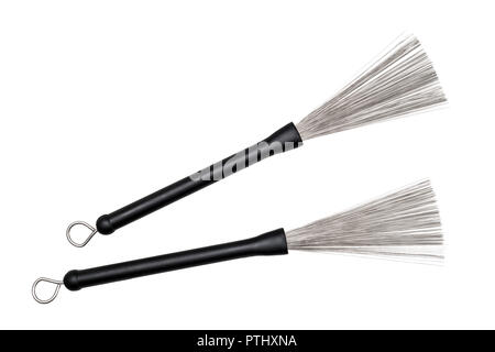 pair of drum brushes on white background - Stock Image