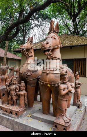 Exhibit of stone carvings of horses typical of Rajasthan in the National Crafts Museum, New Delhi, India - Stock Image
