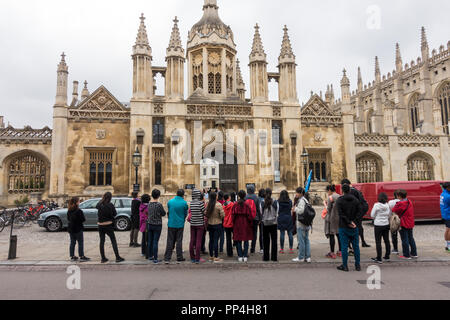 Tourist party in front of Kings college main gate - Stock Image