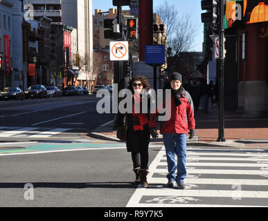 Woman and Autistic Son Crossing Street in Chinatown, Washington DC - Stock Image