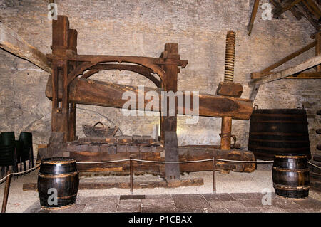 Huge ancient wine press in the Wine Museum Beaune Burgundy France - Stock Image