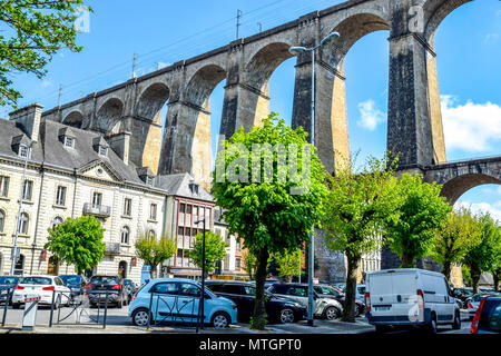 The 1800s viaduct in Morlaix, Brittany, France looms over the town below. - Stock Image