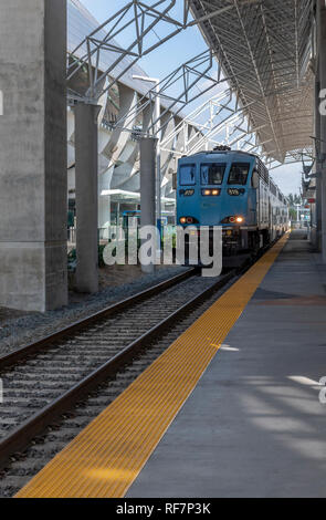 The new Tri-Rail station and trains at Miami Airport. The railway route takes passengers north to Fort Lauderdale and beyond to Mangolia Park Station. - Stock Image