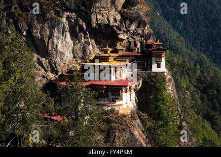 Red-and-gold roofed Tiger's Nest Monastery (Taktshang Goemba), perched on cliff near Paro, Bhutan - Stock Image