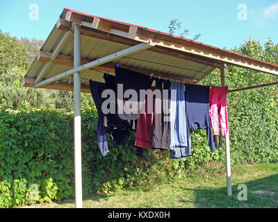 Simple homemade shed for drying washed clothes - Stock Image