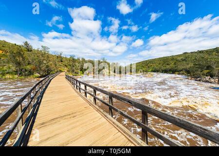 Wooden bridge over the Swan River at Bells Rapids. - Stock Image
