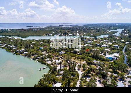 Sanibel Island Florida Gulf of Mexico Sanibel Captiva Road Dinkins Bayou Blind Pass Pine Island Sound homes aerial overhead bird's eye view above - Stock Image
