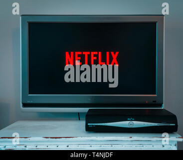 Netflix logo displayed on a television, Netflix is a television streaming service founded in 1997 in California, USA - Stock Image