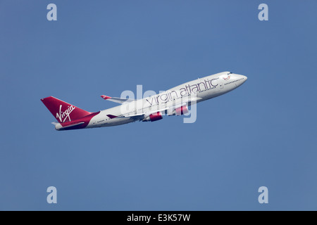 Virgin Atlantic Boeing 747-400 G-VROC Mustang Sally in metallic red livery climbing away from Heathrow airport - Stock Image