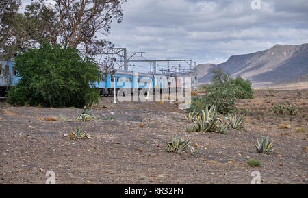 View of the land of the Karoo where The Premier Classe train bound for Cape Town makes a scheduled stop in the hamlet of Matjisfontein, South Africa - - Stock Image