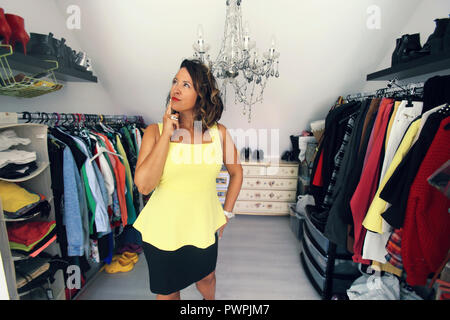 Brunette woman in her dressing room. - Stock Image