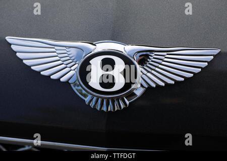 Monte-Carlo, Monaco - June 16 2019: Shining Bentley Winged 'B' Logo (Emblem) On The Bonnet Of A Luxury Black Car At Monte-Carlo, Monaco. Close Up View - Stock Image