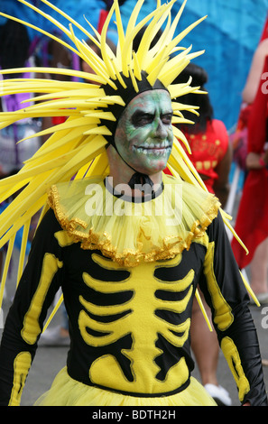 Man in a Scary Yellow and Black Costume at the Notting Hill Carnival 2009 - Stock Image