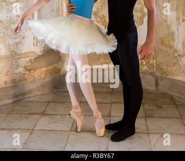 Cuba, Havana. Close-up of two ballet dancers from waist down. Credit as: Wendy Kaveney / Jaynes Gallery / DanitaDelimont.com - Stock Image