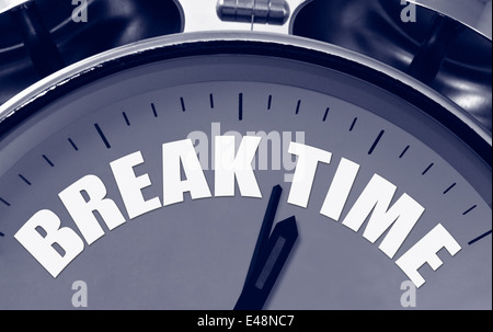 Break Time on a clock face great concept for short breaks during a busy schedule or presentation. - Stock Image