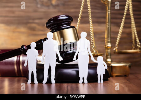Separation Of Family Figure Cut Out In Front Of Judge Gavel - Stock Image