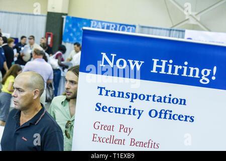Miami Florida Job Fair career employment jobless employer recruiting economic crisis booth Hispanic man men man labor job seeker - Stock Image