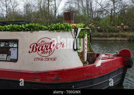 Pictured on Regents Canal near Kings Cross, London, England. The Floating Barber Shop is based on a narrow boat that cruises the canal system. - Stock Image