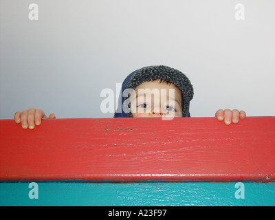 Boy looking after his mother or farther in a public nursery at the playground in afternoon - Stock Image