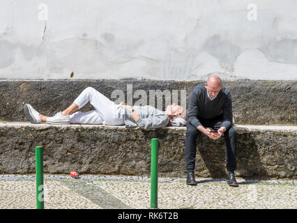 Senior couple of tourists taking a break at the streets of Sintra, Portugal - Stock Image