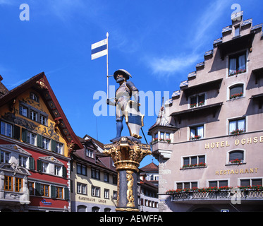 Switzerland Zug famous for low taxes fountain statue typical architecture old city center - Stock Image