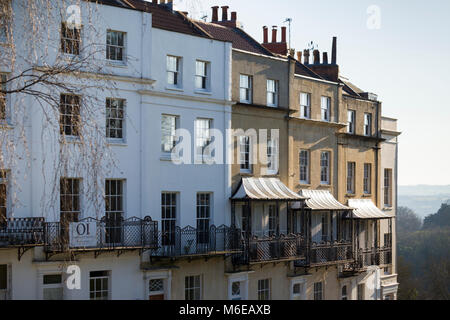 A terrace of Georgian houses with elegant iron balconies at Sion Hill, Clifton, Bristol, overlooking the Suspension - Stock Image