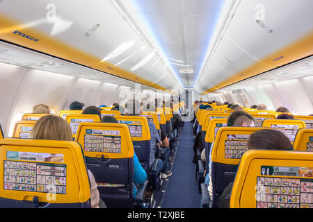 Passengers on an aircraft aeroplane  ready for take off on a Ryanair flight from Liverpool airport - Stock Image