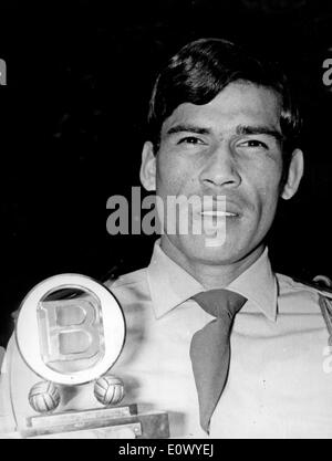 Jun 16, 1964 - Paris, France - (File Photo) NESTOR COMBIN is a soccer player from France with Argentinian origin. He was striker, mainly with Olympique Lyonnais and France national team. PICTURED: NESTOR COMBIN with an award for being the best player of the 1963-64 season. - Stock Image