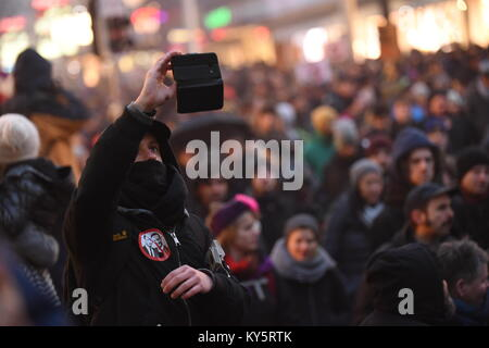 Vienna, Austria. 13th Jan, 2018. hooded protester takes a selfie during an anti-government demonstration. Credit: - Stock Image