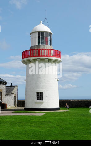This beautiful white lighthouse is located on the shore of Dungarvan Bay in County Waterford,Ireland. - Stock Image