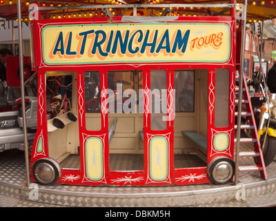 Toy bus ride on carousel in Altrincham Market - Stock Image