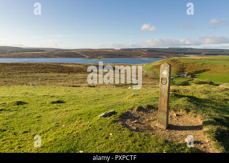 Walking guide post at Llyn Brenig reservoir in the Denbigh moors for the archaeological trail showing visitors bronze age monuments in the area - Stock Image
