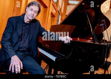 Berlin, Germany. 22nd Mar, 2019. Walter Lindner, outgoing State Secretary at the Federal Foreign Office and Germany's designated Ambassador to India, will be sitting at the piano after handing over his office as Foreign State Secretary to his successor Leendertse. Credit: Christoph Soeder/dpa/Alamy Live News - Stock Image