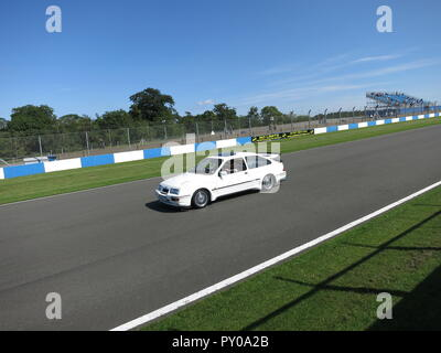 Ford Sierra RS Cosworth in white shown at donnington park race circuit at the RS owners club national day 2017 leading a parade lap mk1 1st generation - Stock Image