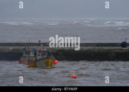 Lyme Regis, UK. 3rd March, 2019. Huge waves from Storm Freya batter Lyme regis sea front.Met Office has issued a yellow warning for much of the southwest UK Wind gusting to of over 60mph expect causing disruption and damage. Credit: PaulChambers /Alamy Live News - Stock Image