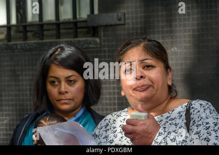 London, UK. 10th August 2018. Relatives of Shahidul Alam at the Bangladesh High Commission in London at a protest by relatives and friends, including several well-known photographers. They called for the immediate release of Shahidul Alam, seized from his house by police on Sunday shortly after he gave an interview to Al Jazeera over Skype on the road safety protests in Bangladesh. k into custody after the hospital v Credit: Peter Marshall/Alamy Live News - Stock Image