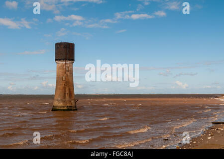 A view of the Low Light lighthouse, now converted to a water tower, in the Humber Estuary at Spurn Point, East Yorkshire. - Stock Image