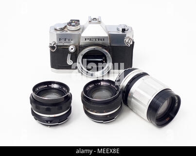 An old Petri FT EE Fully Automatic 35mm format SLR, film camera body, with lenses.   T - Stock Image