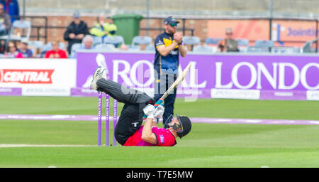 Brighton, UK. 7th May 2019 - Luke Wright of Sussex Sharks rolls on his back as he avoids a bouncer during the Royal London One-Day Cup match between Sussex Sharks and Glamorgan at the 1st Central County ground in Hove. Credit : Simon Dack / Alamy Live News - Stock Image