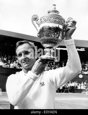Jul 05, 1969; Wimbledon, UK; In the mens singles final at Wimbledon this afternoon, ROD LAVER from Australia, beat Australian John Newcombe, 6-4, 5-7, 6-4 and 6-4. The picture shows Rod Laver held high the trophy after winning the mens singles final at Wimbledon today for the fourth time. - Stock Image