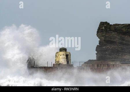 Storm Freya battering the Cornish coast with huge powerful waves breaking over the historic Monkey Hut on the pier at Portreath in Cornwall - Stock Image
