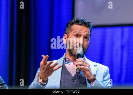 Bonn, Germany - June 8 2019: Cas Anvar (Canadian actor - The Expanse) talks about his experiences in The Expanse at FedCon 28, a four day sci-fi convention. FedCon 28 took place Jun 7-10 2019. - Stock Image