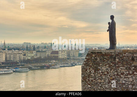BUDAPEST, HUNGARY - FEBRUARY 02: Bronze statue of Virgin Mary by sculptor Laszlo Matyassy outside Buda Castle, overlooking Budapest city across the Da - Stock Image