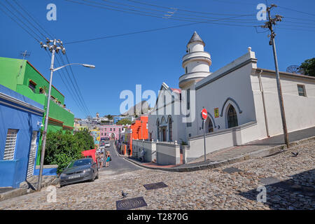 Mosque and colorful houses and streets of Bo Kaap, with Lion's head in background. Cape Town, South Africa, March 21, 2019. - Stock Image