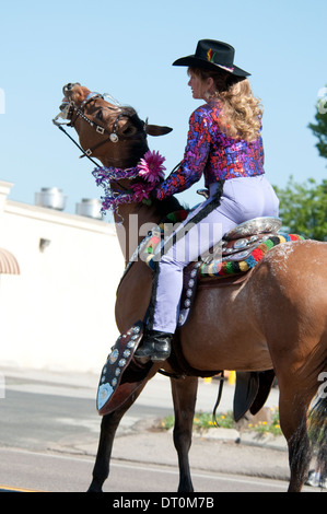 Cowgirl on a horse with decorated saddle and stirrups at the Western Days Parade, Lakeside, California, USA - Stock Image